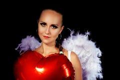 Un ange doux avec un ballon Images libres de droits
