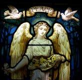 Un angelo con le colombe e la pace Fotografie Stock Libere da Diritti