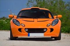 Un arancio sportscar Fotografie Stock Libere da Diritti