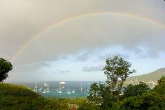 Un arco iris tropical sobre la bahía del ministerio de marina Fotografía de archivo libre de regalías