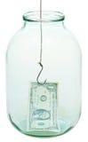 Un argent et hameçon du dollar dans le pot en verre Images libres de droits