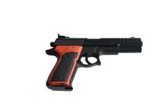 Un arma del juguete en un fondo blanco Fotos de archivo