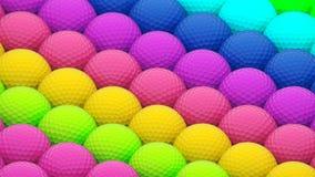 Un arsenal vibrante enorme de pelotas de golf coloridas foto de archivo libre de regalías