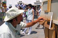 Un artista en Plaza de San Marcos Fotografía de archivo