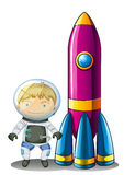 Un astronauta al lado de un cohete Fotos de archivo
