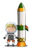 Un astronauta al lado del cohete Imagen de archivo