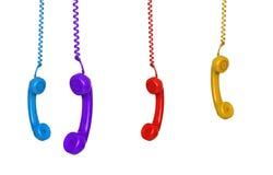 Un'attaccatura colorata di quattro telefoni Immagine Stock Libera da Diritti