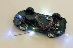 Un'automobile del giocattolo senza un corpo superiore fotografia stock libera da diritti