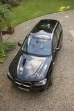 Un'automobile nera del lusso 4x4 Fotografia Stock