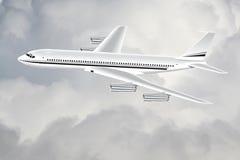 Un avion dans le ciel photo stock