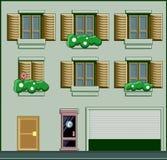 Un bâtiment avec des fenêtres et des usines Et une cabine de téléphone dans le f Photo libre de droits