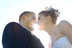 Un bacio attraverso il sole Fotografia Stock