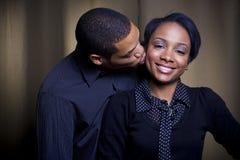 Un baiser sur la joue Images libres de droits