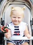 Un bambino con una lecca-lecca Fotografie Stock Libere da Diritti