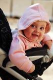 Un bambino di 6 mesi nel passeggiatore Fotografia Stock Libera da Diritti