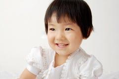 Un bambino di sorriso Fotografie Stock Libere da Diritti