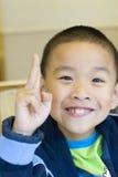 Un bambino felice Immagini Stock