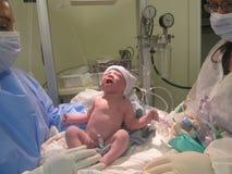 Un bambino nasce Immagine Stock