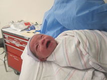 Un bambino nasce Fotografia Stock