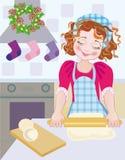 Un bambino a natale nell'avvenimento quando cuociono i biscotti Fotografie Stock