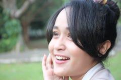 Un beau sourire de femme Image stock