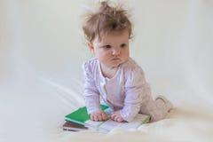 Un bebé con los libros Foto de archivo libre de regalías