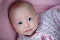 Un bebé en rosa Imagenes de archivo