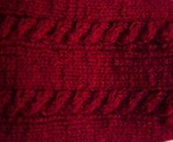 Un bello primo piano di un modello tricottato caldo Filato di lana naturale delle pecore fotografia stock