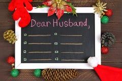 Un bianco ha incorniciato la lavagna con un messaggio ad un marito Fotografie Stock