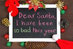 Un bianco ha incorniciato la lavagna con un messaggio a Santa Claus Fotografia Stock