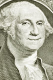 Un billet d'un dollar avec George Washington de sourire Photographie stock libre de droits