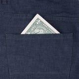 Un billet d'un dollar dans la poche Photos stock