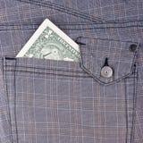 Un billet d'un dollar dans la poche Photographie stock