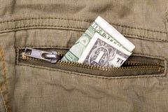 Un billet d'un dollar dans une poche Photos stock