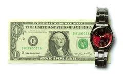 Un billet d'un dollar et une montre Photos stock