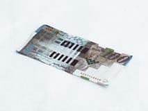 Un billete de banco digno de 100 shekels israelíes aislado en un fondo blanco Fotografía de archivo