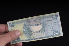 Un billete de banco iraquí viejo imágenes de archivo libres de regalías