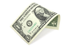 Un billete de dólar dobló en un tubo Fotos de archivo
