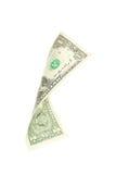 Un billete de dólar que cae en el fondo blanco Imágenes de archivo libres de regalías