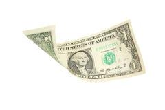Un billete de dólar que cae en el fondo blanco Fotografía de archivo