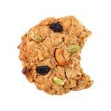 un biscotto del cereale con il morso isolato su bianco fotografia stock libera da diritti