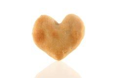 Un biscuit en forme de coeur avec la réflexion Photos stock