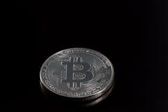 Un bitcoin d'argento Immagini Stock