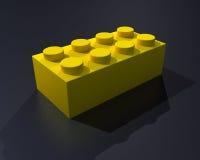 Un blocchetto di colore giallo di lego 3D Fotografia Stock