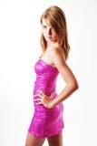 Un blonde en alineada rosada Imagen de archivo libre de regalías