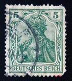 Un bollo della posta ha stampato in IMPERO TEDESCO con il ` della REICH del ` DEUTSCHES dell'iscrizione, circa 1902 Fotografia Stock