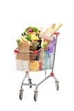 Un bolso de compras por completo con las tiendas de comestibles Fotografía de archivo libre de regalías