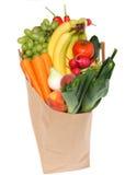 Un bolso de tienda de comestibles por completo de frutas sanas Imagenes de archivo
