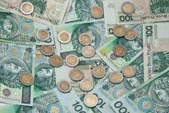 Un bon nombre de billets de banque et de pièces de monnaie polonais Photos libres de droits