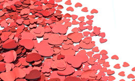 Un bon nombre de coeurs rouges sur le blanc Photos stock